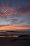 Windansea, La Jolla, California; waves crash on Windansea Beach as the sun sets over the Eastern Pacific Ocean