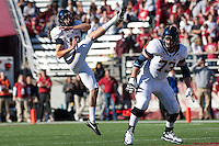 Bryan Anger kicks the punt, protected by Richard Fisher. The University of California football defeated Washington State University 20-13 at Martin Stadium in Pullman, Washington on November 6th, 2010.