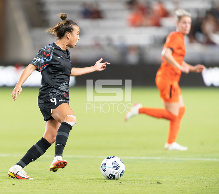 Mallory Pugh #9 of the Chicago Red Stars brings the ball up the field during a game between Chicago Red Stars and Houston Dash at BBVA Stadium on September 10, 2021 in Houston, Texas.