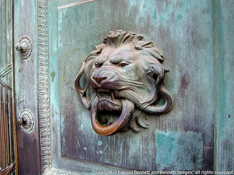 A lion serves as a door handle on the Ile de la Cite in Paris, France.