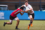 Oakeley Mellish (r) of United Arab Emirates fights for the ball during the match between United Arab Emirates and Singapore of the Asia Rugby U20 Sevens Series 2016 on 12 August 2016 at the King's Park, in Hong Kong, China. Photo by Marcio Machado / Power Sport Images