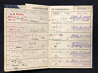 BNPS.co.uk (01202 558833)<br /> Pic: HAldridge/BNPS<br /> <br /> Also included is Smith's service book from Minia.<br /> <br /> A poignant cross made from drift wood from the Titanic by a seaman tasked with recovering the bodies from the disaster as surfaced 107 years later.<br /> <br /> The small religious symbol was delicately hand carved by Samuel Smith, a joiner on the cable-laying ship Minia which was tasked with searching for bodies.<br /> <br /> Mr Smith was so moved by the macabre experience that he honoured the victims by creating the wooden cross on a three-tiered plinth.<br /> <br /> He made it from a piece of oak wood he plucked from the ocean that has come from the sunken liner.<br /> <br /> The archive is estimated to sell for £35,000 at H Aldridge in Devizes.