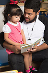 Education Preschool toddler 2s program father reads to daughter at the start of the day
