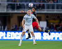 WASHINGTON, DC - MAY 13: Boris Sakulic #2 of Chicago Fire FC goes up for a header with Andy Najar #14 of D.C. United during a game between Chicago Fire FC and D.C. United at Audi FIeld on May 13, 2021 in Washington, DC.