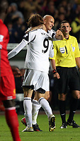 Pictured L-R: Michu of Swansea celebrating his equaliser with co-scorer Jonjo Shelvey, making the score 2-2. Monday 16 September 2013<br /> Re: Barclay's Premier League, Swansea City FC v Liverpool at the Liberty Stadium, south Wales.