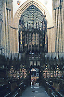 York: York Minster Choir, looking west to Pulpitum and surmounted organ pipes. Crossing and nave beyond. Photo '90.