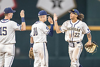 Michigan Wolverines outfielder Jordan Brewer (22) celebrates with teammates after beating the Vanderbilt Commodores in Game 1 of the NCAA College World Series Finals on June 24, 2019 at TD Ameritrade Park in Omaha, Nebraska. Michigan defeated Vanderbilt 7-4. (Andrew Woolley/Four Seam Images)