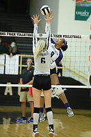 Fayetteville's Rosana Hicks (8) sends the ball over the net Tuesday, Sept. 15, 2020, as Bentonville's Gloria Cranney (6) defends during play in Tiger Arena in Bentonville. Visit nwaonline.com/200916Daily/ for today's photo gallery. <br /> (NWA Democrat-Gazette/Andy Shupe)