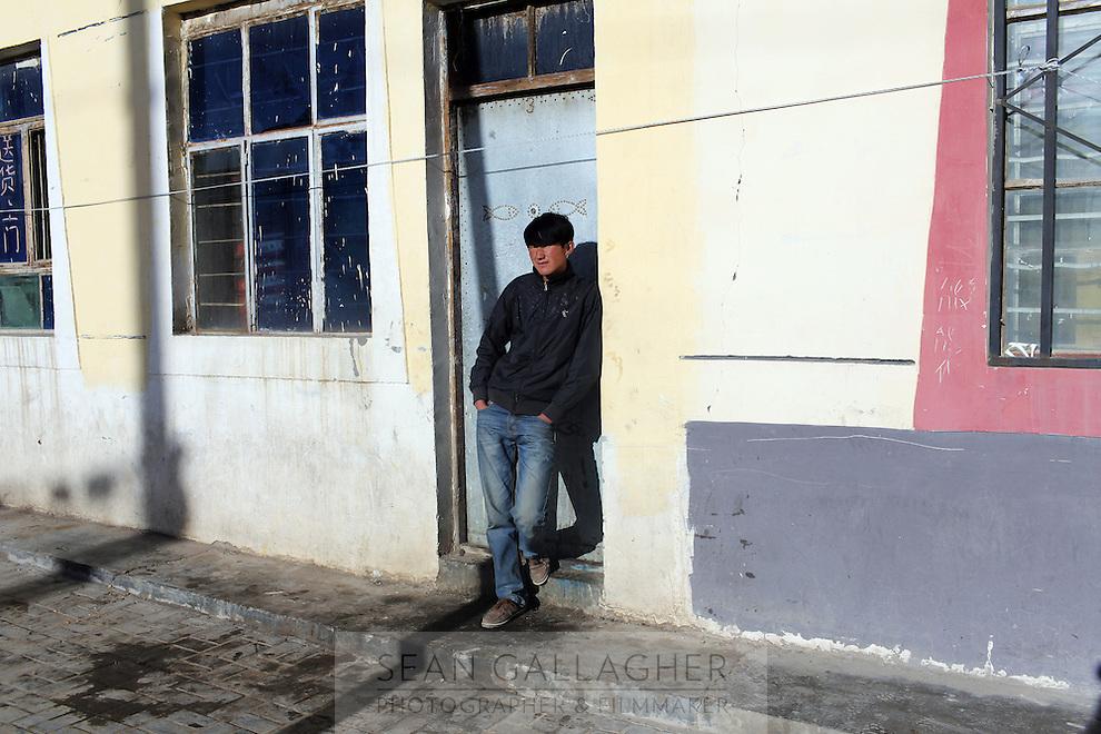 A Tibetan man in a town on the Tibetan Plateau, in western China.