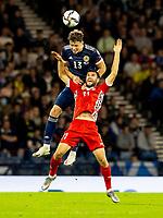4th September 2021; Hampden Park, Glasgow, Scotland: FIFA World Cup 2022 qualification football, Scotland versus Moldova: Jack Hendry of Scotland with a climbing header against Radu Ginsari of Moldova