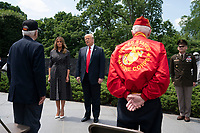 US President Donald J. Trump, alongside First Lady Melania Trump, greets Korean War veterans at the Korean War Veterans Memorial in Washington, DC, USA, 25 June 2020. On 24 June, in the wake of anti-racism protests aimed at monuments around the country, the president activated the National Guard to provide unarmed security for monuments in the nation's capital.<br /> Credit: Jim LoScalzo / Pool via CNP/AdMedia