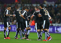 Riyad Mahrez of Leicester City celebrates scoring his goal to make the score 0-1 by pointing to his hip during the Barclays Premier League match between Swansea City and Leicester City played at The Liberty Stadium on 5th December 2015