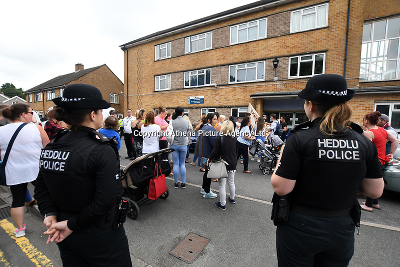 """Pictured: Protesters gather outside Pembroke police station, west Wales, UK. Thursday 13 July 2017<br /> Re: Angry protesters staged a six-hour demonstration through the night after concerns a convicted criminal was living in their community.<br /> Crowds of people chanting and setting fire to bins gathered in Gwilliam Court, in Monkton, Pembrokeshire, at 9.30pm on Tuesday.<br /> Police were called and took two people from a property before the disturbance ended six hours later.<br /> On Wednesday, about 100 protesters gathered outside a council office.<br /> The crowd outside the office in Argyle Street, Pembroke Dock, were shouting and chanting about the situation in Monkton, with some saying they were not leaving until they had answers.<br /> Dyfed-Powys Police said officers were present and """"engaging with the community about their concerns""""."""