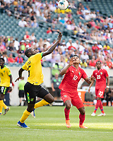 PHILADELPHIA, PA - JUNE 30: Edgar Barcenas #10 and Je-Vaughn Watson #15 contest the ball during a game between Panama and Jamaica at Lincoln Financial Field on June 30, 2019 in Philadelphia, Pennsylvania.