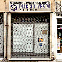 A shop that sells parts for Piaggio Vespa motorscooters on Filippou Street.