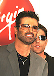 "George Michael makes an In-Store Appearance for New CD ""Patience"" at the Virgin Megastore in Hollywood, May 21st 2004. With him is partner Kenny Goss."