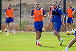 St Johnstone Training...  McDiarmid Park<br />Reece Devine pictured with Chris Kane during training ahead of Saturday's opening league game of the season at Ross County.<br />Picture by Graeme Hart.<br />Copyright Perthshire Picture Agency<br />Tel: 01738 623350  Mobile: 07990 594431