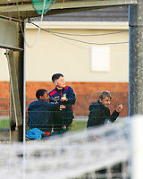 Young supporters watch the game from the wall.<br /> <br /> Cobh Ramblers v Cork City, SSE Airtricity League Division 1, 28/5/21, St. Colman's Park, Cobh.<br /> <br /> Copyright Steve Alfred 2021.