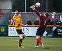 Alloa's Mitchel Megginson knocks the ball over Ayr Utd Goalkeeper Ally Brown to score their first goal .
