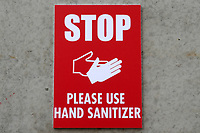 Stop, Please Use Hand Sanitizer sign during Leyton Orient vs Oldham Athletic, Sky Bet EFL League 2 Football at The Breyer Group Stadium on 27th March 2021