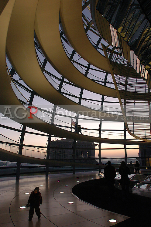 in Berlin, Germany in late December 2008. Tourists visit The Reichstag building in Berlin photographed December 28, 2008. It was opened in 1894 and housed the Reichstag until 1933, when it was severely damaged in a fire supposedly set by Dutch communist Marinus van der Lubbe, who was later beheaded for the crime. The building remained in ruins until the reunification of Germany, when it underwent reconstruction led by internationally renowned architect Norman Foster. After its completion in 1999, it became the meeting place of the modern German parliament, the Bundestag. (Photo by Alan Greth)