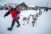 Aliy Zirkle leads her dogs to a parking spot at the Kaltag checkpoint during the 2017 Iditarod on Sunday morning March 12, 2017.<br /> <br /> Photo by Jeff Schultz/SchultzPhoto.com  (C) 2017  ALL RIGHTS RESERVED