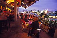 People enjoying happy hour at Brew Moon, a brew pub in Ward Center, Honolulu