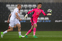 Pictured: George Legg of Reading (R) takes a kick Monday 15 May 2017<br />Re: Premier League Cup Final, Swansea City FC U23 v Reading U23 at the Liberty Stadium, Wales, UK