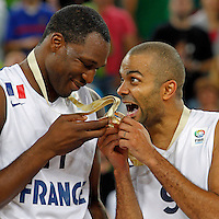 "France`s Tony Parker (R) celebrate with Florent Pietrus (L) after European basketball championship ""Eurobasket 2013""  final game between France and Lithuania in Stozice Arena in Ljubljana, Slovenia, on September 22. 2013. (credit: Pedja Milosavljevic  / thepedja@gmail.com / +381641260959)"