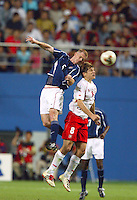 John O'Brien goes up for a header. The USA lost 3-1 against Poland in the FIFA World Cup 2002 in Korea on June 14, 2002.