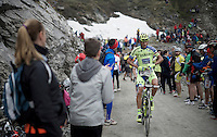 Roman Kreuziger (CZE/Tinkoff-Saxo) stuffing a gazette under his jersey (against the cold down the descent) up the dirt roads of the Colle delle Finestre (2178m)<br /> <br /> Giro d'Italia 2015<br /> stage 20: Saint Vincent - Sestriere (199km)