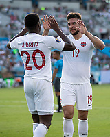 CHARLOTTE, NC - JUNE 23: Jonathan David #20 and Lucas Cavallini #19 celebrate a goal during a game between Cuba and Canada at Bank of America Stadium on June 23, 2019 in Charlotte, North Carolina.