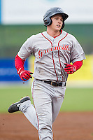 Kevin Mager (24) of the Greenville Drive rounds the bases after hitting a home run against the Kannapolis Intimidators at CMC-Northeast Stadium on April 6, 2014 in Kannapolis, North Carolina.  The Intimidators defeated the Drive 8-5.  (Brian Westerholt/Four Seam Images)