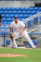 Dunedin Blue Jays first baseman Rowdy Tellez (8) holds a runner on during the first game of a doubleheader against the Palm Beach Cardinals on July 31, 2015 at Florida Auto Exchange Stadium in Dunedin, Florida.  Dunedin defeated Palm Beach 7-0.  (Mike Janes/Four Seam Images)