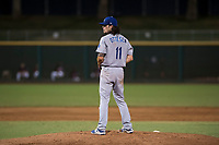AZL Dodgers relief pitcher Riley Ottesen (11) prepares to deliver a pitch during an Arizona League game against the AZL Indians 2 at Goodyear Ballpark on July 12, 2018 in Goodyear, Arizona. The AZL Indians 2 defeated the AZL Dodgers 2-1. (Zachary Lucy/Four Seam Images)