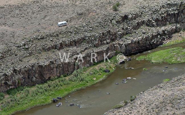 Airstream trailer alone banks of Rio Grande River, Taos County, New Mexico. June 2014