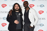 Romeo Stodart and David McAlmont<br /> at The Ivor Novello Awards 2017, Grosvenor House Hotel, London. <br /> <br /> <br /> ©Ash Knotek  D3267  18/05/2017
