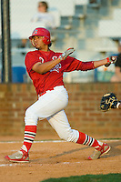 Romulo Ruiz #16 of the Johnson City Cardinals follows through on his swing versus the Burlington Royals at Howard Johnson Stadium June 27, 2009 in Johnson City, Tennessee. (Photo by Brian Westerholt / Four Seam Images)