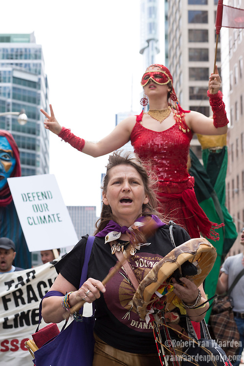 Carrie Lester of the Six Nations and from Toronto sings and leads the march through downtown. Around 1500 people came out in Toronto today to take part in the Defend our Climate rally. The rally was a part of a national day of action drawing attention to pipelines, tar sands, climate change and other resource extraction that is exacerbating climate change, affecting First Nations and leading Canada towards a Petrostate.