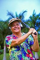 Senior part-Hawaiian woman plays golf at the Pali Golf Course, Windward Oahu