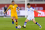 Eldor Shomurodov of Uzbekistan (R) fights for the ball with Mark Milligan of Australia (L) during the AFC Asian Cup UAE 2019 Round of 16 match between Australia (AUS) and Uzbekistan (UZB) at Khalifa Bin Zayed Stadium on 21 January 2019 in Al Ain, United Arab Emirates. Photo by Marcio Rodrigo Machado / Power Sport Images