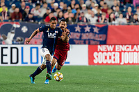 FOXBOROUGH, MA - SEPTEMBER 21: Brandon Bye #15 of New England Revolution dribbles as Sebastian Saucedo #23 of Real Salt Lake defends during a game between Real Salt Lake and New England Revolution at Gillette Stadium on September 21, 2019 in Foxborough, Massachusetts.