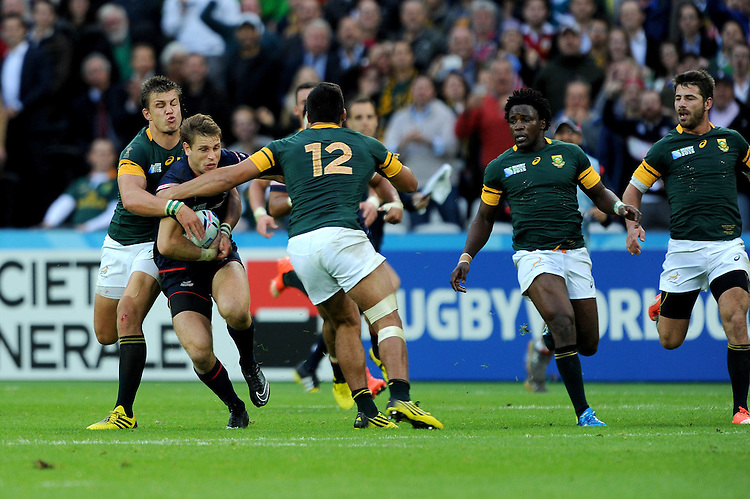 07 October 2015: Blaine Scully of USA is tacked by Handre Pollard and Damian de Allende of South Africa during Match 31 of the Rugby World Cup 2015 between South Africa and USA - Queen Elizabeth Olympic Park, London, England (Photo by Rob Munro/CSM)
