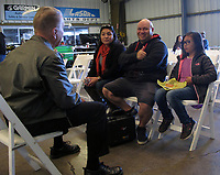 Pilot John Swanstrom discusses aviation career options and flight training with a girl and her parents after a flight during the Experimental Aircraft Association Young Eagles rally at Lampson Field (102), Lakeport, Lake County, California