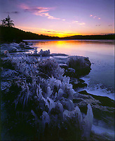 Wintergreen Point shoreline covered in ice at Pharoah Lake in the Adirondack Mountains in New York state