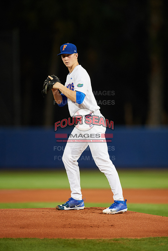 Florida Gators starting pitcher Brady Singer (51) gets ready to deliver a pitch during a game against the Siena Saints on February 16, 2018 at Alfred A. McKethan Stadium in Gainesville, Florida.  Florida defeated Siena 7-1.  (Mike Janes/Four Seam Images)