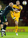 HIBERNIAN'S PAUL HANLON AND MOTHERWELL'S MICHAEL HIGDON CHALLENGE FOR THE BALL
