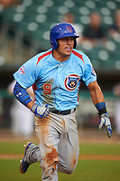 Tennessee Smokies first baseman Anthony Giansanti (9) runs to first during a game against the Montgomery Biscuits on May 25, 2015 at Riverwalk Stadium in Montgomery, Alabama.  Tennessee defeated Montgomery 6-3 as the game was called after eight innings due to rain.  (Mike Janes/Four Seam Images)