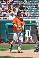 Robbie Grossman (15) of the Fresno Grizzlies comes up to bat against the Salt Lake Bees in Pacific Coast League action at Smith's Ballpark on June 14, 2015 in Salt Lake City, Utah.  (Stephen Smith/Four Seam Images)
