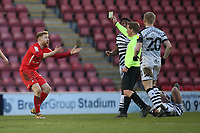 James Brophy of Leyton Orient is shown a yellow card during Leyton Orient vs Forest Green Rovers, Sky Bet EFL League 2 Football at The Breyer Group Stadium on 23rd January 2021